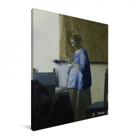 Brieflezende vrouw in het blauw - Schilderij van Johannes Vermeer Canvas